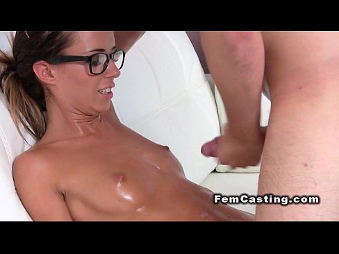Oiled female agent masturbates after casting solo