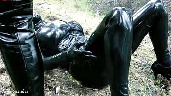 sexy redhead Mistress in rubber