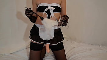 Naughty maid fucks a guy with a strap-on
